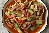 西红柿炒豆腐皮的做法