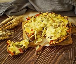 黑椒牛肉粒时蔬黑米披萨的做法