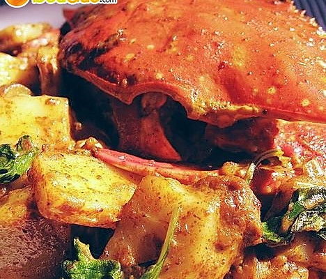 螃蟹炒年糕的做法
